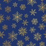 Vector golden and nay blue snowflakes seamless repeat pattern background. Great for winter holiday fabric, giftwrap. Packaging, covers, invitations. Surface Stock Photos