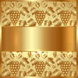 Vector Golden Plate with Grapes and Leaves. In the Background Stock Photos