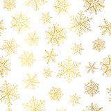 Vector golden and white snowflakes seamless repeat pattern background. Great for winter holiday fabric, giftwrap. Packaging, covers, invitations. Surface Royalty Free Stock Photography