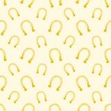 Vector Goldnahtloses Muster von glücklichen Pferdeschuhen Stockfotos