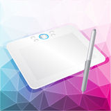 Vector graphics tablet with stylus. Realistic vector illustration of graphic tablet with a stylus on an abstract background with triangles Royalty Free Stock Image