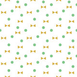 Vector green dots and golden bows seamless pattern. Cute geometrical wallpaper with pastel colors Stock Photos