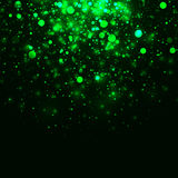 Vector green glowing light glitter background. Vector green glowing light glitter abstract background. Magic energy glow light effect. Star burst with sparkles Stock Images
