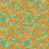 Vector green and orange hand drawn leaves repeat pattern. Suitable for gift wrap, textile and wallpaper stock illustration
