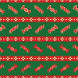 Red and green striped pattern of Christmas candies royalty free stock image