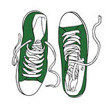 Vector green sports sneakers with white laces isolated Royalty Free Stock Photo