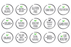 Vector grey symbols with green leaves on white. Healthy Food logos. Royalty Free Stock Photos