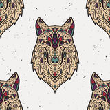 Vector grunge colorful seamless pattern with tribal style wolf with ethnic ornaments Stock Photography