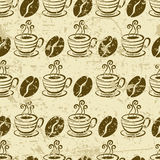 Vector grunge seamless pattern with coffee beans and cup. Stock Image