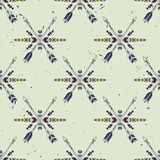 Vector grunge seamless pattern with crossed ethnic arrows and tribal ornament Stock Photos