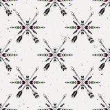 Vector grunge seamless pattern with crossed ethnic arrows and tribal ornament Royalty Free Stock Photos