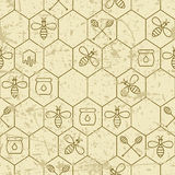 Vector grunge seamless pattern with linear bees, honeycombs, honey dipper symbol and design elements. Royalty Free Stock Photo