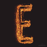 Vector Grungy Font 001. Letter E. Abstract bright golden shimmer glowing round particles vector background. Scatter shine tinsel light effect. Hand made grunge Royalty Free Stock Photos