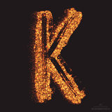 Vector Grungy Font 001. Letter K. Abstract bright golden shimmer glowing round particles vector background. Scatter shine tinsel light effect. Hand made grunge Royalty Free Stock Photos