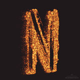 Vector Grungy Font 001. Letter N. Abstract bright golden shimmer glowing round particles vector background. Scatter shine tinsel light effect. Hand made grunge Stock Photos