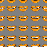 Vector Halloween background. Seamless pattern of vampire smiles in traditional colors of the holiday. Stock Photography