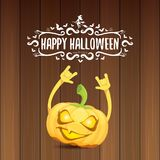 Vector halloween funky rock n roll style pumpkin character and calligraphic halloween hand drawn text on wooden Royalty Free Stock Photography