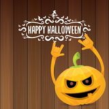 Vector halloween funky rock n roll style pumpkin character and calligraphic halloween hand drawn text on wooden Stock Photo