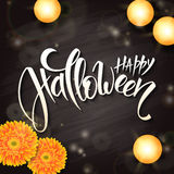 Vector halloween poster with hand lettering greetings label - happy halloween - on blackboard with gerbera flower  Royalty Free Stock Photos