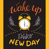 Vector hand drawin lettering phrase - wake up and enjoy new day - with alarm clock and brunches. Design for t-shirt Stock Image
