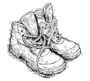Vector Hand Drawing of Pair of Worn Hiking Boots. Vector artistic pen and ink hand drawing illustration of pair of worn hiking boots Royalty Free Stock Photography