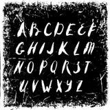 Vector hand drawn alphabet  on black grunge retro background Stock Image
