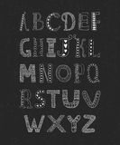 Vector hand drawn alphabet. Isolated on black background with retro texture, doodle letters collection on chalkboard Stock Photo