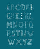 Vector hand drawn alphabet. Isolated on blue background, doodle letters collection Stock Photography