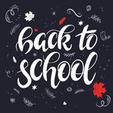 Vector hand drawn back to school lettering with branches, swirls, flowers, leafs and greetings label. Can be used as a Royalty Free Stock Image