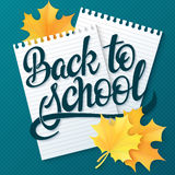 Vector hand drawn back to school lettering greetings label - back to school - with realistic paper pages and leaves. Can be used a. S greetings card or poster Royalty Free Stock Images