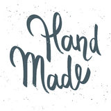 Vector hand drawn calligraphy lettering phrase. 'Hand Made'. Grunge texture Vector Illustration