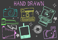 Vector hand drawn chalk illustration of cameras from different times. Photographic equipment set. Royalty Free Stock Image