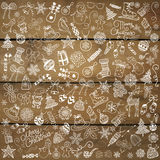 Vector Hand Drawn Christmas Doodles on Wood Texture Royalty Free Stock Photos