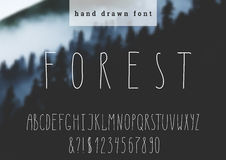 Vector hand drawn font. Modern narrow letters. Hand drawn typography on blurred background. Vector hand drawn font. Modern narrow letters. Hand drawn typography Royalty Free Stock Photography