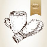 Vector hand drawn illustartion of cocoa cup,and gloves. Vintage engraved style. Christmas decoration. Royalty Free Stock Photo