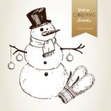 Vector hand drawn illustartion of snowman with fir balls and gloves. Vintage engraved style. Christmas decoration. Royalty Free Stock Photography