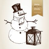 Vector hand drawn illustartion of snowman and lantern. Vintage engraved style. Christmas decoration. Stock Photo