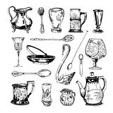 Vector hand drawn ink set of antique glass and metall dishes, glasses and spoons. On white background Stock Image