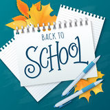 Vector hand drawn lettering greetings label - back to school - with realistic notebook, paper sheets, pens and autumn leaves on ch Royalty Free Stock Photos