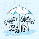 Vector hand drawn lettering quote - enjoy spring rain. With drops  and open umbrella Royalty Free Stock Photo