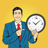 Vector hand drawn pop art illustration of businessman holding watch Stock Image