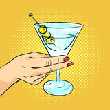 Vector hand drawn pop art illustration of woman hand holding Martini glass Stock Photos