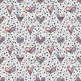 Vector hand drawn seamless pattern, decorative stylized childish hearts. Doodle style, tribal graphic illustration Cute hand drawi. Ng in pink colors. Series of stock illustration