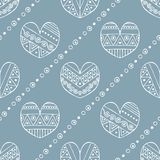 Vector hand drawn seamless pattern, decorative stylized childish hearts. Doodle style, tribal graphic illustration Cute hand drawi. Ng. Line drawing Series of royalty free illustration