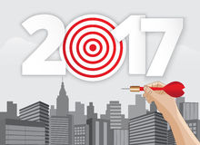 Vector hand holding dart aiming at the business target. Vector hand holding dart aiming at the business target new year 2017.illustration EPS10 Stock Images
