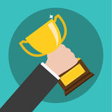 Vector of Hand Holding a Trophy ,winning in business.  Royalty Free Stock Photos