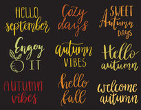 Hello autumn set. Vector hand lettering autumn phrases set, written in various brush styles with doodle leaves, autumn elements and other. Bright phrases on dark Royalty Free Stock Photos