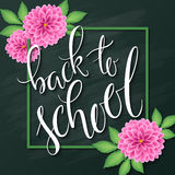 Vector hand lettering greeting text - back to school - with frame and realistic flowers and leafs of dahlia on Royalty Free Stock Photo
