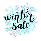 Vector hand lettering illustration Winter sale with doodle snowflakes stock illustration
