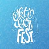 Vector hand lettering oktoberfest label in beer mug shape on doodle background Stock Images